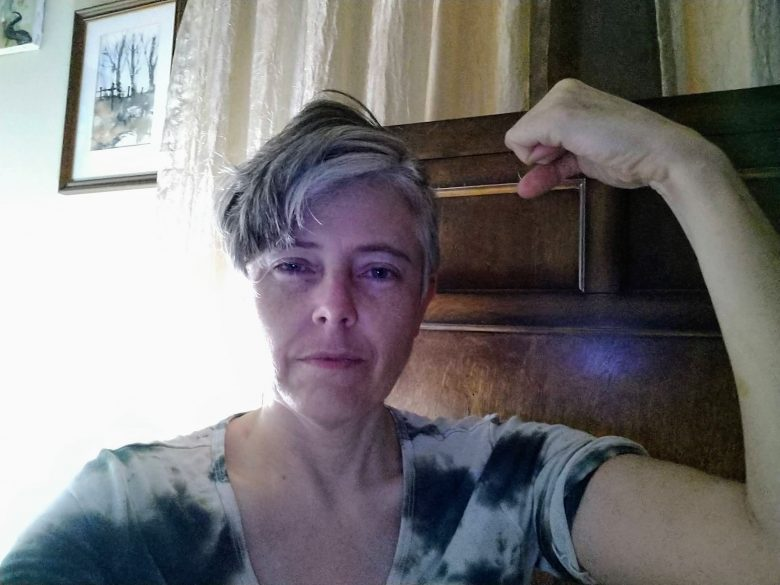 "Photo of the author with her arm in a ""Rosie the riveter"" pose"